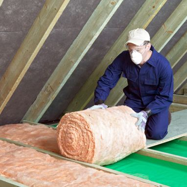 Man rolling out insulation