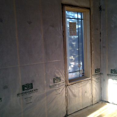 Unfinished insulated wall